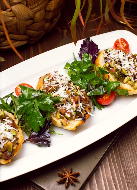 Potato skins loaded with mushrooms, onion, herbs, vegetables and melted cheese Free Photo