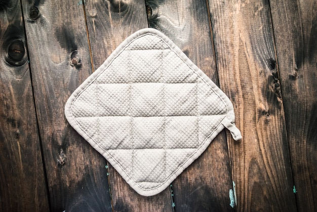 Potholder on a wooden background Premium Photo