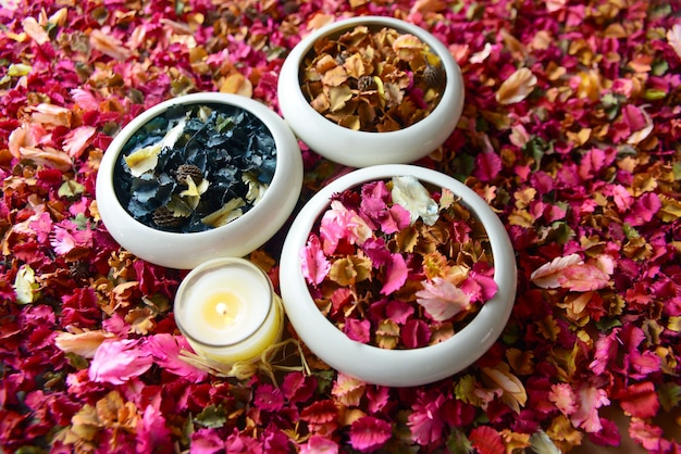 Potpourri or dried petals flowers colorful and scented candles Premium Photo