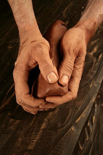 Pottery craftmanship potter hands work clay Premium Photo