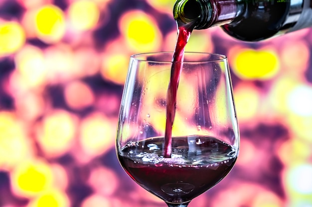Pouring a glass of red wine Free Photo