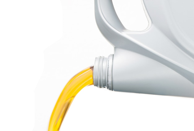 Pouring motor oil on white background