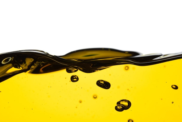 Pouring oil car motor or olive vegetable cooking and bubble isolated on white background Premium Photo