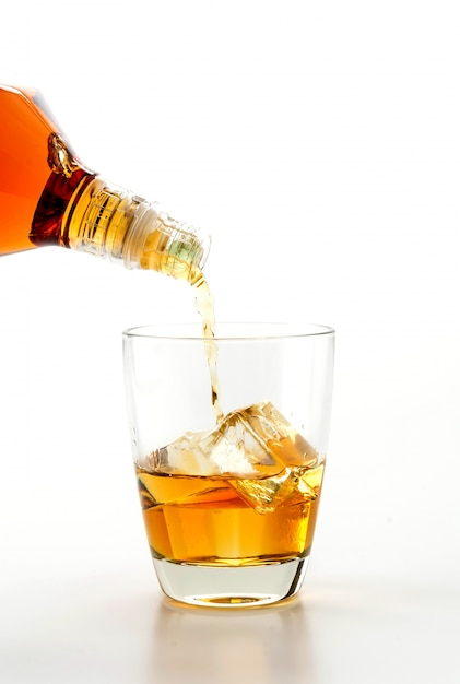 Pouring wisky Free Photo