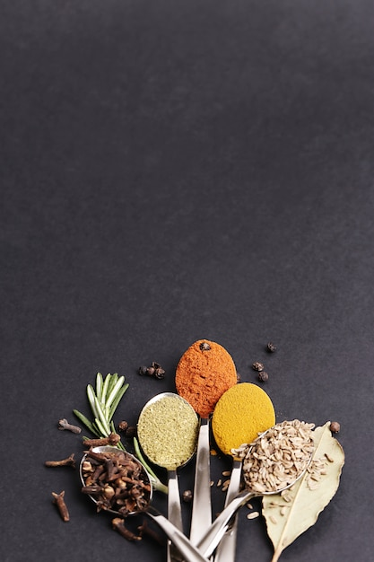 Powder spice on black table, top view Free Photo