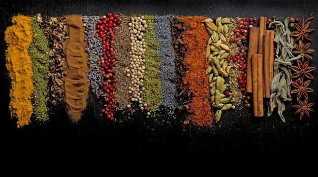 Powder spices on spoons on black wooden table Premium Photo