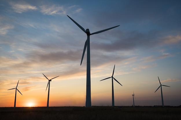 Power generators of windmills at sunset of the day Premium Photo
