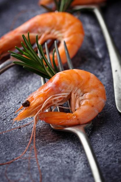 Prawns shrimps on the fork. selective focus Premium Photo