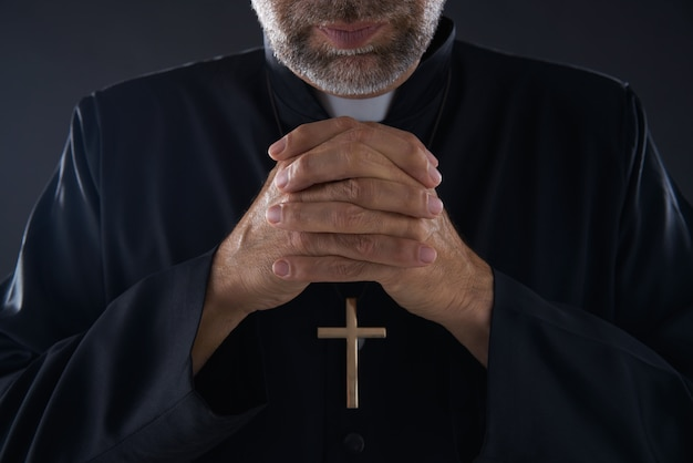 Praying hands priest portrait of male pastor Premium Photo
