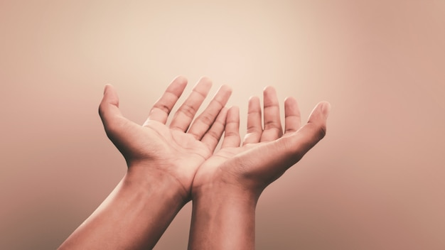 Praying hands with faith in religion and belief in god. power of hope and devotion. Premium Photo
