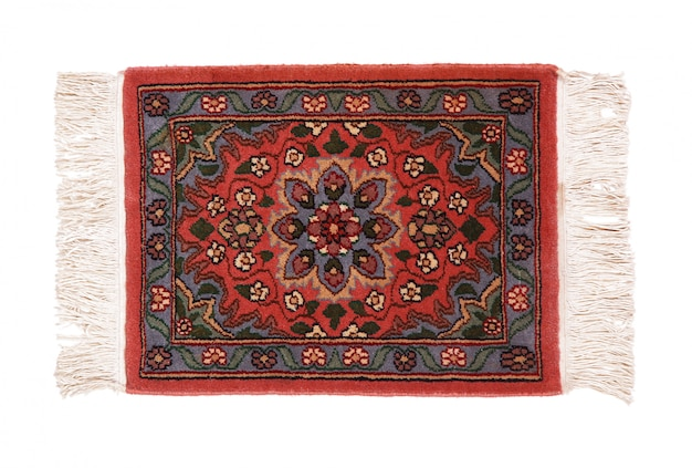 Precious persian carpet on white background Premium Photo