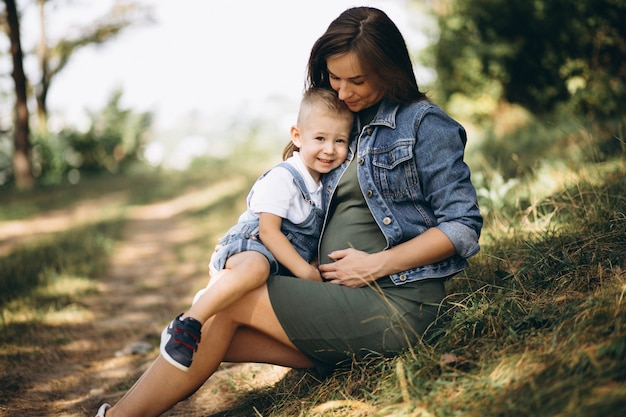 Pregnant woman and her little son Free Photo