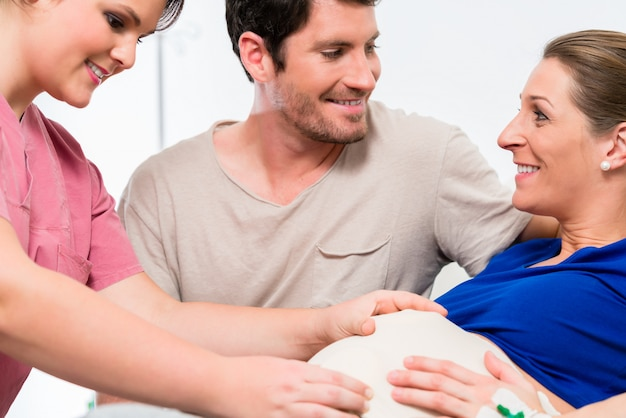 Pregnant woman and her man in delivery room Premium Photo