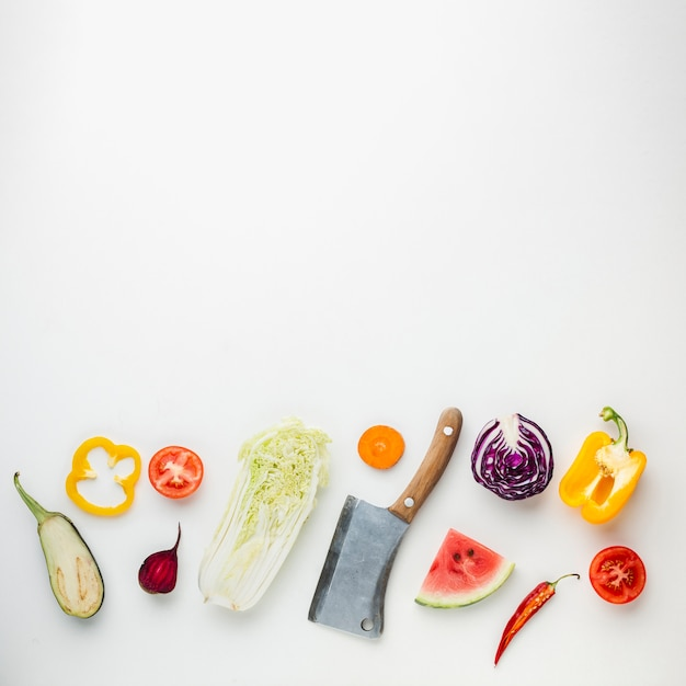 Preparation of a healthy meal on white background Free Photo