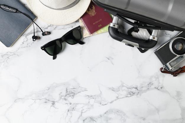 Prepare suitcase accessories and travel items Premium Photo