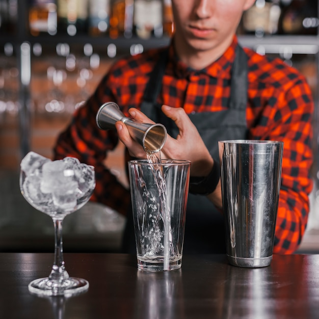 Preparing a refreshing cocktail in a bar Free Photo