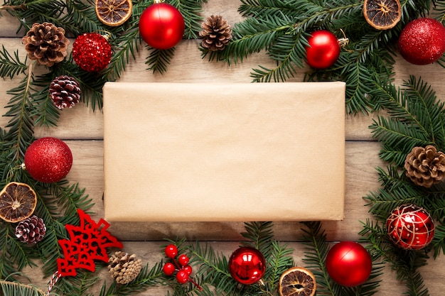 Present box mock-up with christmas decorations Free Photo