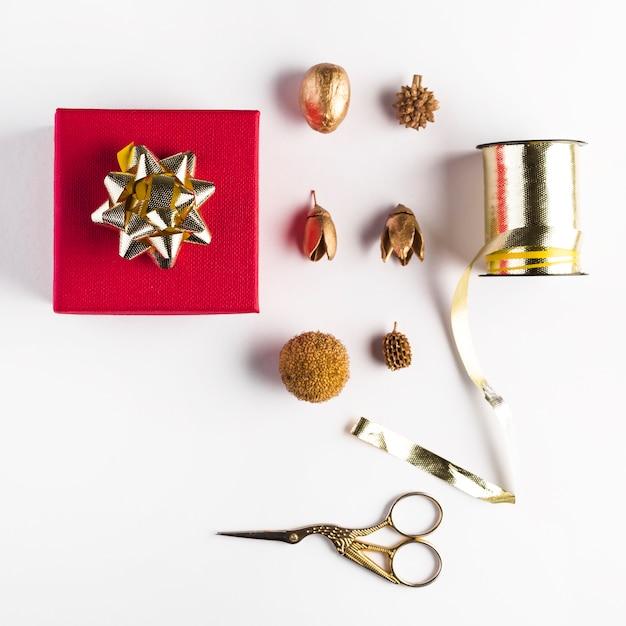 Present box near different decorations Free Photo