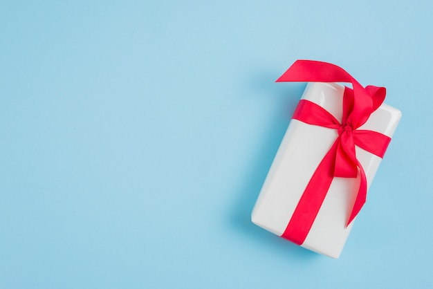 Present box with red ribbon Free Photo