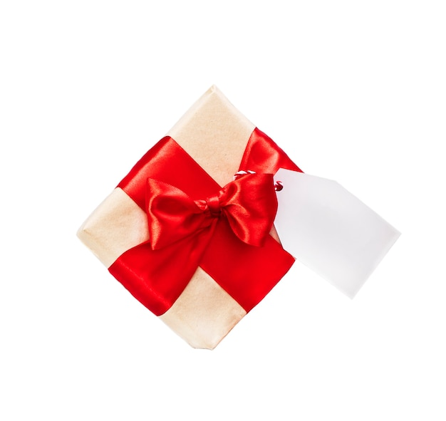 Present box with tag and red ribbon. Premium Photo