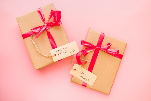 Present boxes with red bows and sale tags Free Photo