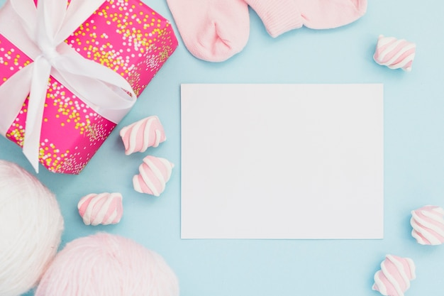 Presents for baby shower and postcard Free Photo