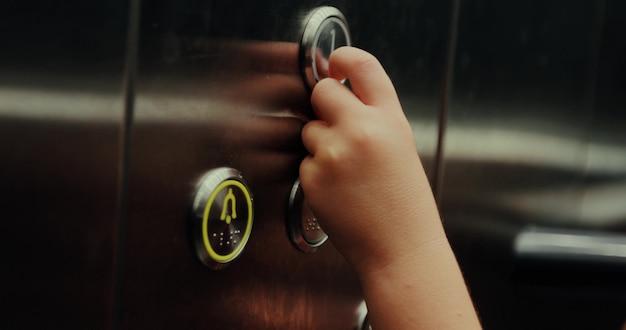 Pressing a button in an elevator Premium Photo