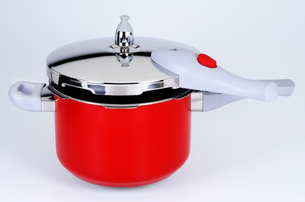 Pressure cooker side view red color Premium Photo