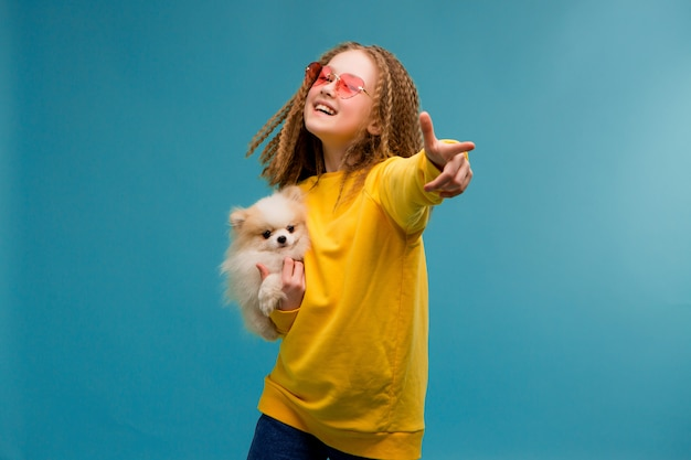 Preteen girl in yellow clothes smiling Premium Photo