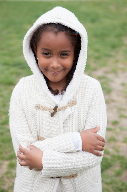 769d13210 Pretty african girl with winter clothes Photo