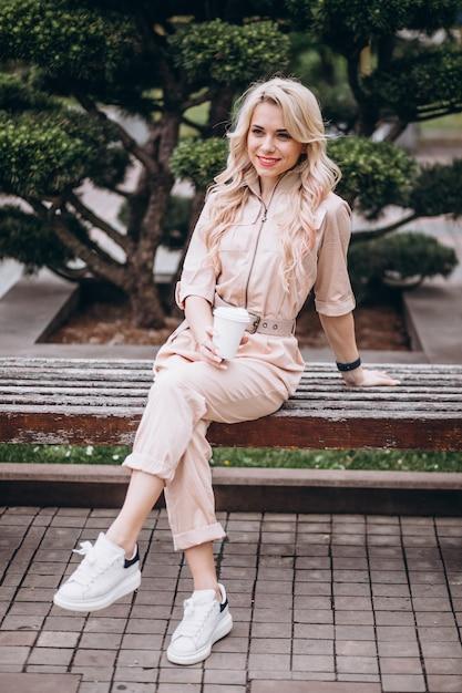 Pretty blonde woman drinking coffee Free Photo