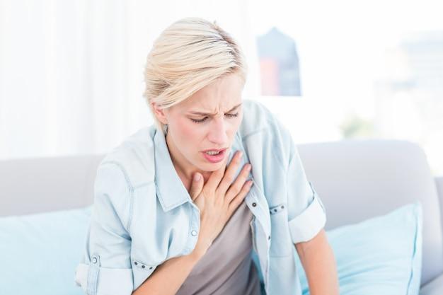 Pretty blonde woman having breath difficulties Premium Photo