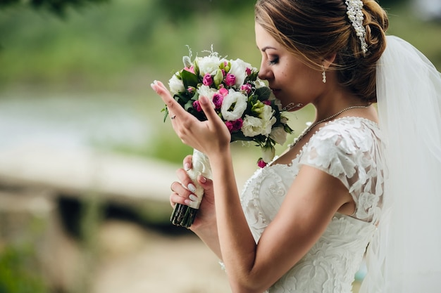Pretty bride smelling bunch Free Photo