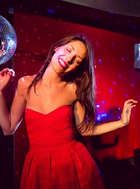 Pretty brunette dancing and smiling Premium Photo