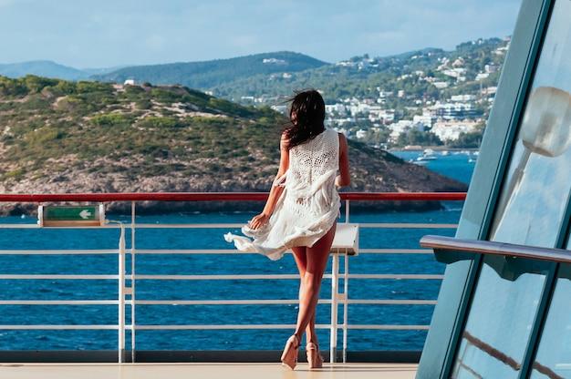 Pretty brunette female enjoying summer sea cruise Premium Photo