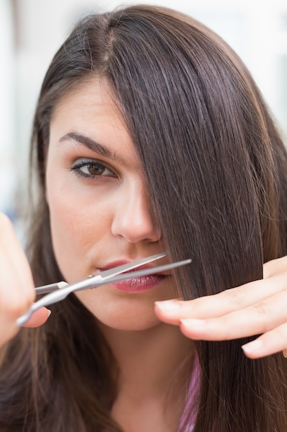 Pretty Brunette Getting Her Hair Cut Photo Premium Download
