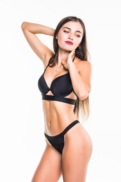 Pretty brunette swimsuit woman posing on white wall Free Photo