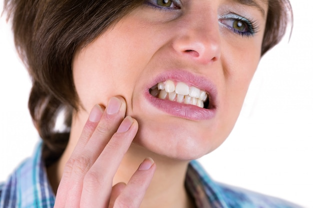 Pretty brunette with a toothache Premium Photo