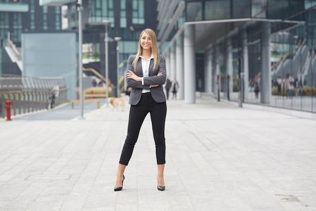 Pretty businesswoman in urban environment Premium Photo