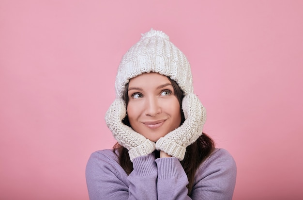 A pretty dark-haired woman with green eyes in knitted hat Premium Photo