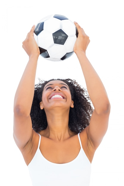 Pretty girl holding football and smiling Premium Photo