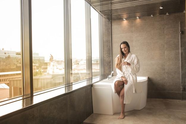 Pretty girl in a luxurious bathroom Premium Photo