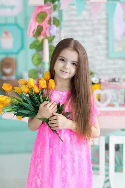 Pretty girl in pink dress with flowers Premium Photo