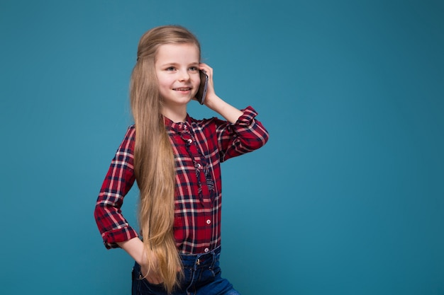 Pretty girl in shirt with long hair hold the phone Premium Photo