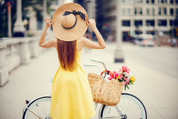 Pretty girl with bicycle Free Photo