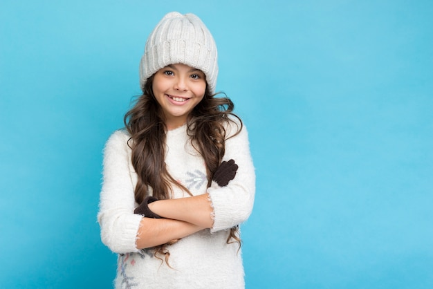 Pretty girl with hat and crossed hands Free Photo