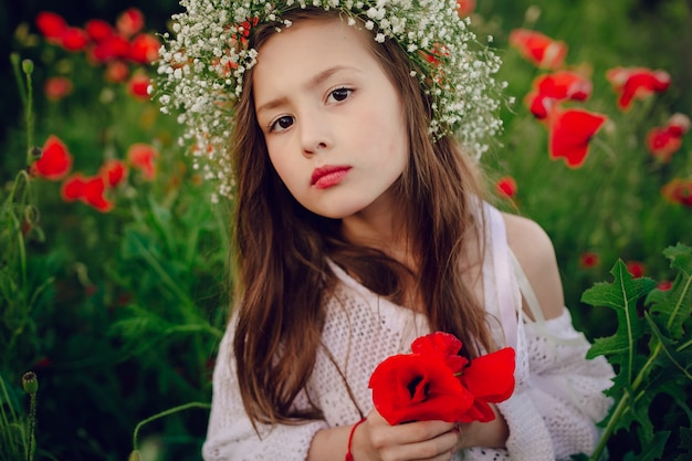 pretty girl with red flowers photo | free download