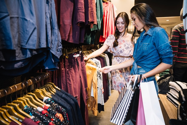 Free Photo   Pretty girls choosing clothes in shop