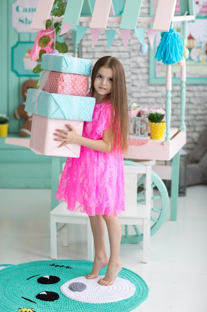 Pretty little girl in dress with presents Premium Photo