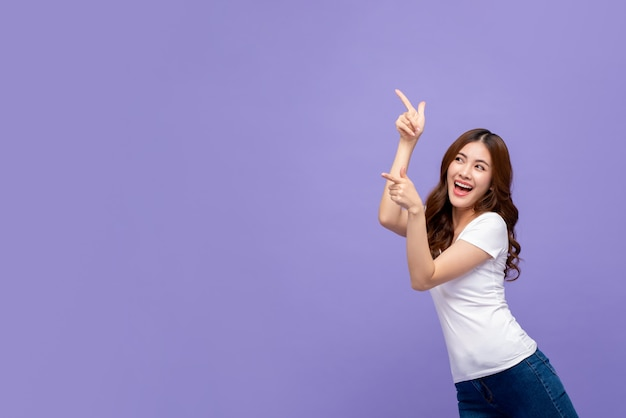 Pretty smiling asian woman pointing hand Premium Photo